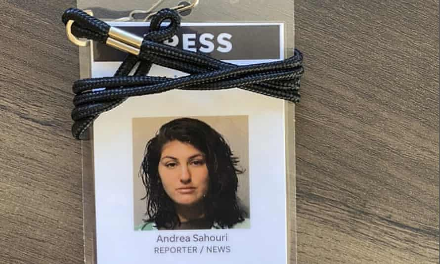 A press badge for Des Moines Register reporter Andrea Sahouri features her jail booking photo from her 31 May 2020 arrest while covering a Black Lives Matter protest.