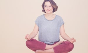 Sophie Heawood in the lotus position, one eye open, one shut