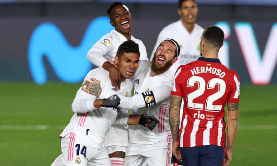 Real Madrid's Casemiro, left, celebrates his goal with Sergio Ramos, right, and Vinícius Júnior on Saturday.