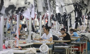 Workers produce coats in a factory in Nantong, Jiangsu province, China