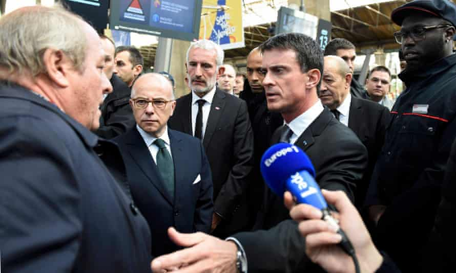 A man looking for his daughter, who went missing in the Paris attacks, speaks to Manuel Valls