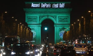 """The Arc de Triomphe illuminated with """"The Paris accord is done"""", to celebrate the first day of the application of the Paris COP21 climate accord."""