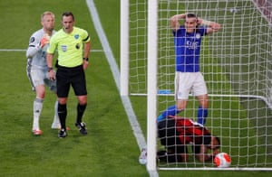 Leicester City's Kasper Schmeichel appeals to referee Stuart Attwell before he sends off Leicester City's Caglar Soyuncu.