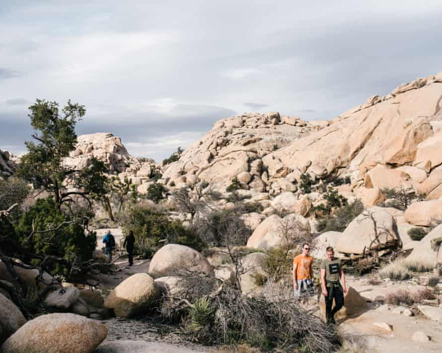 Hikers walk along a trail. The government shutdown is over, for now.