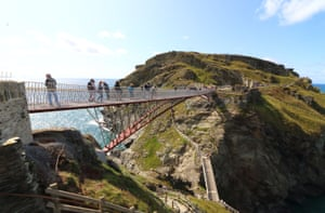 Cornwall, England: A view of the controversial new footbridge reconnecting both halves of Tintagel Castle for the first time in 500 years
