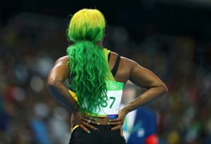 Defending 100m champion Shelly-Ann Fraser-Pryce wins her heat in the fastest time recorded so far.