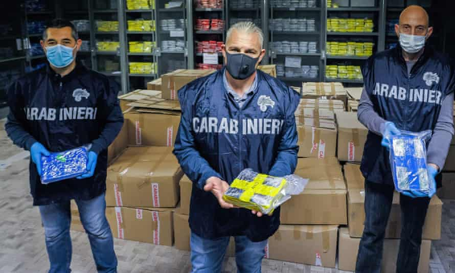 Italian police and three tons of cocaine seized in the port of Livorno this month.