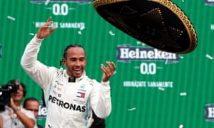 Lewis Hamilton celebrates winning the race by throwing his sombrero high in the air.