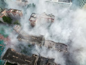 Smoke rises from the debris of the Bingxiong refrigeration company building