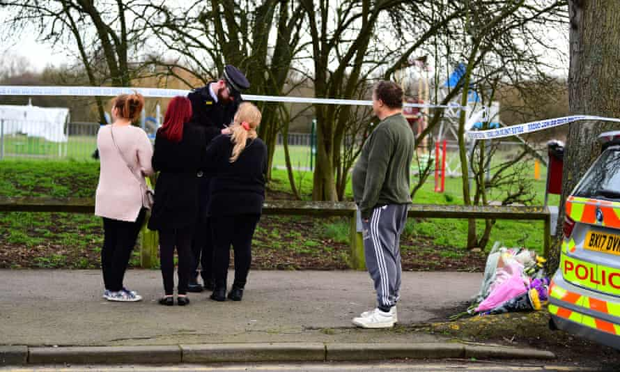 Members of the public speak to a police officer near the scene at St Neot's Road in Harold Hill, east London following the fatal stabbing of a 17-year-old Jodie Chesney on Friday night.