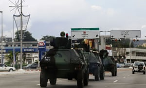 Armoured vehicles move through Libreville as Gabon awaits the official results of presidential election that both claim to have won.