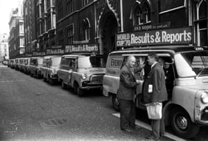 A fleet of London Evening News delivery vans.