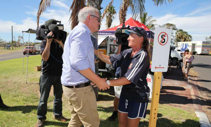 Scott Morrison meets a local resident as he visits cyclone-affected areas in the tourist town of Kalbarri