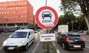 Unofficial traffic signs warn about the danger of pollution caused by diesel cars at a demonstration for cleaner air in Stuttgart, Germany, last October.