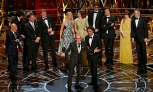 Michael Keaton and director Alejandro Inarritu accept the Oscar for best picture for his film Birdman