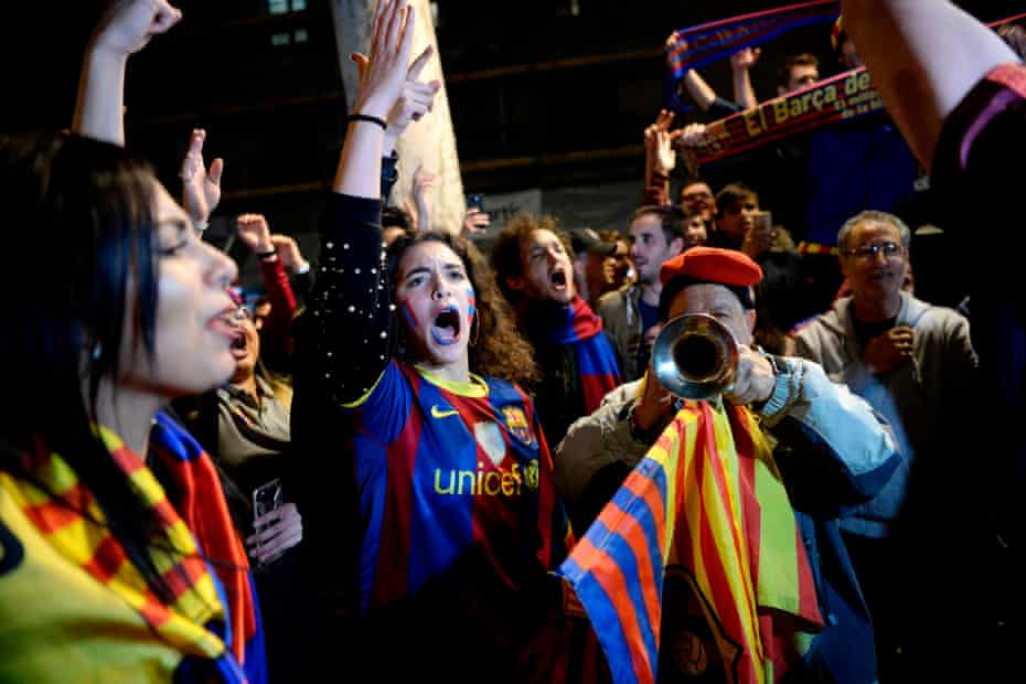 Barcelona fans celebrate in the city after claiming their 25th La Liga title.