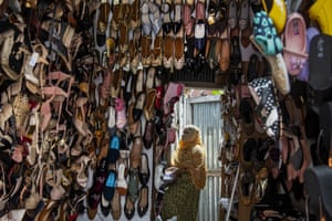 Guwahati, India. A shopkeeper arranges shoes during a partial relaxation of restrictions to curb the spread of coronavirus