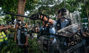 Police charge protesters after a rally in Sheung Shui on Saturday