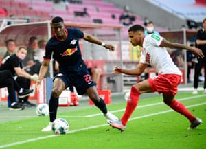 Nordi Mukiele of Leipzig and Ismail Jakobs of Cologne in action.