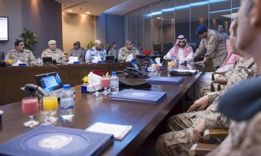 Saudi Defence Minister Prince Mohammad bin Salman is briefed by officers on the military operations in Yemen at the command center in Riyadh