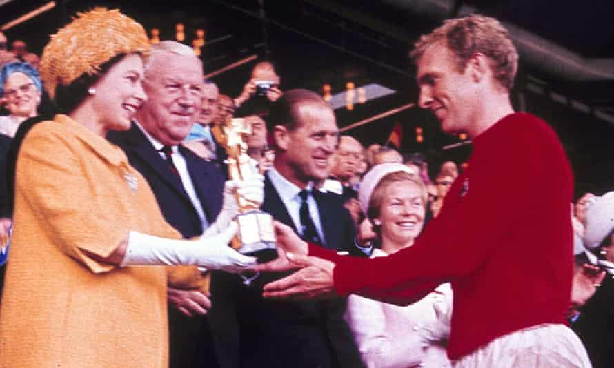 Queen Elizabeth II presenting the Jules Rimet trophy to England's team captain Bobby Moore in 1966.
