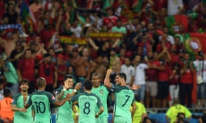 Portuguese players and fans celebrate their victory at the end of the Euro 2016 semi-final football match against Wales.