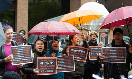 Protesters outside police headquarters as a disciplinary hearing takes place for Daniel Pantaleo in New York City, on 13 May.