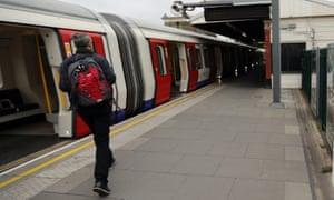A man on an empty Parsons Green station platform