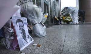 Flowers and a photo of the whistleblower doctor Li Wenliang at a hospital in Wuhan