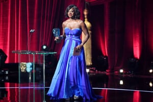 Viola Davis goes to collect her award for best actress in a supporting role for Fences