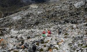 Aymara indigenous women descend after practicing on the glacier
