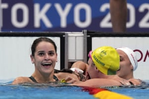 Kaylee McKeown, left, of Australia is congratulated by compatriot Emily Seebohm and Canada's Kylie Masse, right, after winning the final of the women's 100-meter backstroke at the 2020 Summer Olympics.