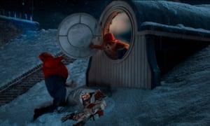 Paddington Bear knocks over the burglar in the M&S Christmas ad