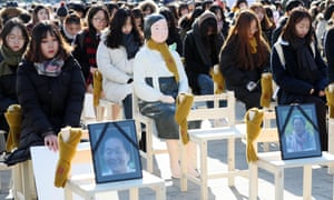 Protesters sit on 300 chairs placed in front of the Japanese embassy in Seoul, South Korea, on Wednesday to highlight the issue of comfort women.