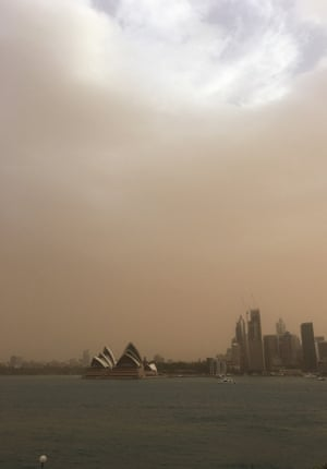 Smoke shrouds the Sydney Opera House as bushfires rage across parts of New South Wales