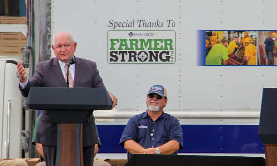 The agriculture secretary, Sonny Perdue, addresses an agriculture department event in Mills River, North Carolina, in August at which he led a chant of 'four more years' for Donald Trump, who was also present.