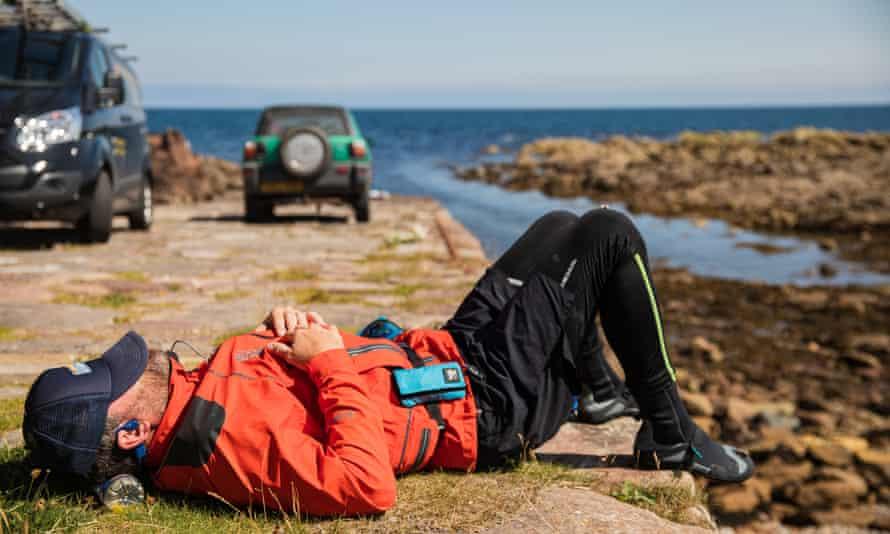 Brendon lying on his back on terra firma