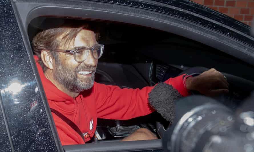 Jürgen Klopp arrives home after celebrating Liverpool's Premier League title with his squad.