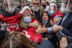 Istanbul, Turkey: Demonstrators, wearing face masks for protection against the coronavirus, wrestle with Turkish police during a May Day rally