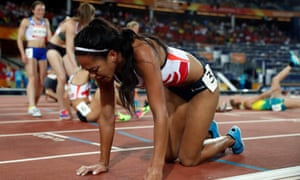 Katarina Johnson-Thompson looks to be in a bit of pain after finishing the race.