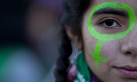 A protester poses for a photo during a march in Buenos Aires on 4 June where demonstrators demanded and end to violence against women and legal abortion.