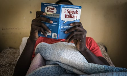 A migrant man learns Italian at the Papa Francisco centre for minors in eastern Sicily.