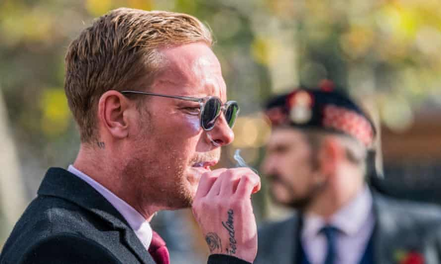 Reclaim party leader Laurence Fox, with a freedom tattoo on his hand, pays his respects on Remembrance Sunday.