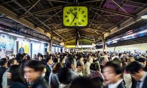 A crowded train platform at Shinjuku station in Tokyo.