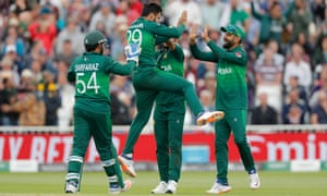 Pakistan's Shadab Khan (second left) is congratulated by teammates as he celebrates taking the wicket of England's Joe Root.