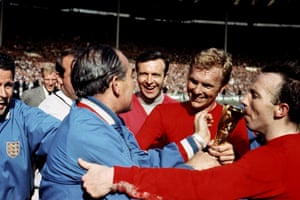 Manager Alf Ramsey is congratulated by trainer Harold Shepherdson and Stiles as Moore presents him with the Jules Rimet trophy after England's 4-2 win