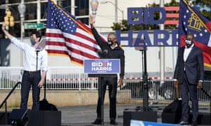 Barack Obama with Jon Ossoff and Raphael Warnock, after speaking at a rally as he campaigns for Joe Biden, 2 November 2020, in Atlanta.