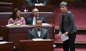 The leader of the Australian Greens, Senator Richard Di Natale, centre, speaks to the leader of the opposition in the Senate, Penny Wong.
