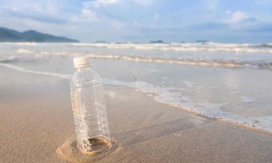 An empty plastic bottle on a beach