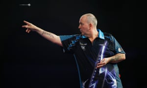 Phil Taylor keeps his eye on the target as throws during his win over Kevin Painter at Alexandra Palace.